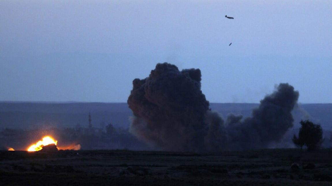 File: A US military plane bombs the northern Syrian city of Baghouz.