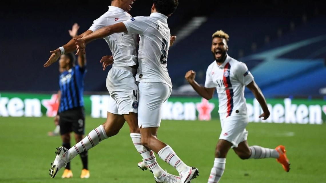 Paris Saint-Germain's Brazilian defender Marquinhos (R) celebrates after scoring a goal during the UEFA Champions League quarter-final football match between Atalanta and Paris Saint-Germain at the Luz Stadium in Lisbon on August 12, 2020.