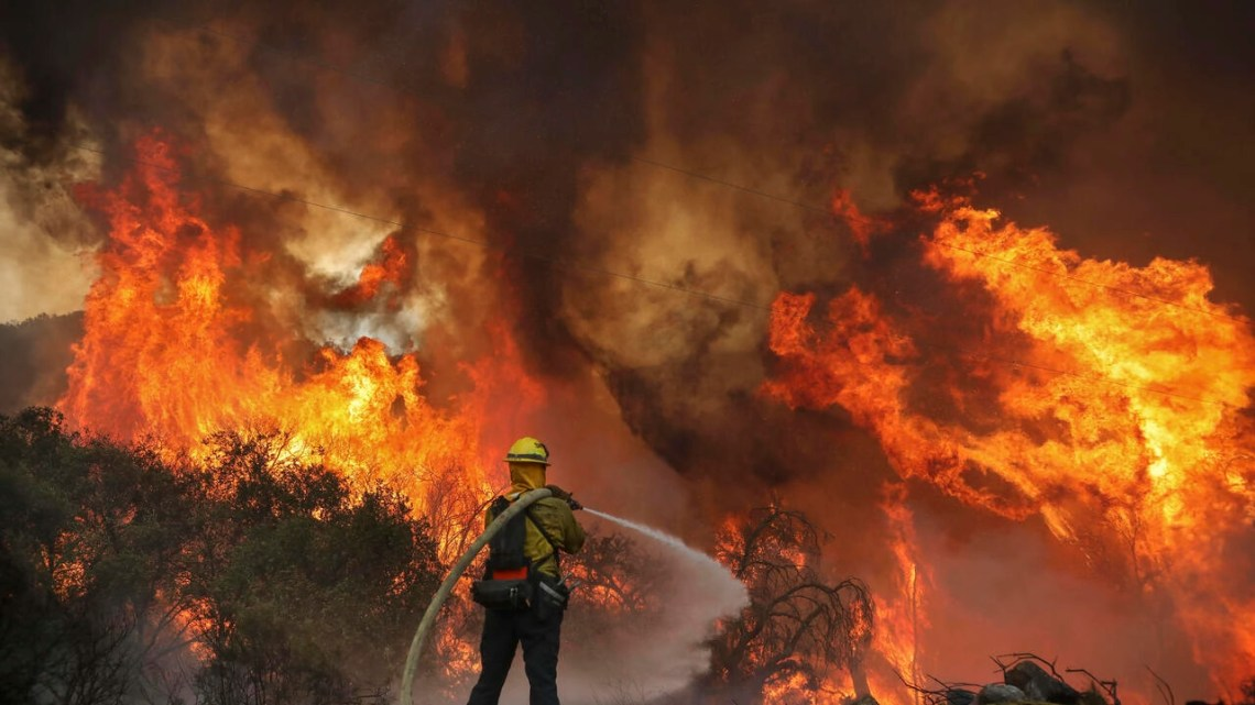 San Miguel County Firefighters battle a brush fire along Japatul Road during the Valley Fire in Jamul, California