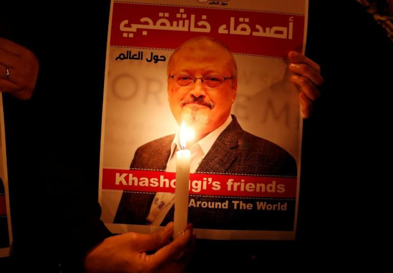 A protester holds a poster with a photo of Saudi journalist Jamal Khashoggi outside the Saudi consulate in Istanbul, Turkey.  Archive.