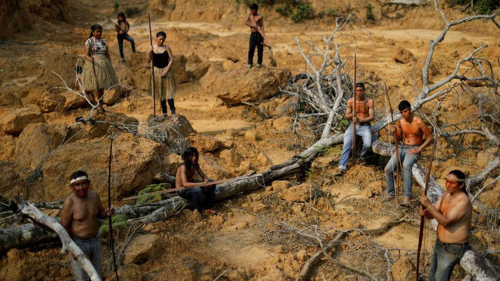 Indigenous people from the Mura tribe show a deforested area on unmarked indigenous lands within the Amazon rainforest near Humaita, Amazonas state, Brazil, on August 20, 2019.