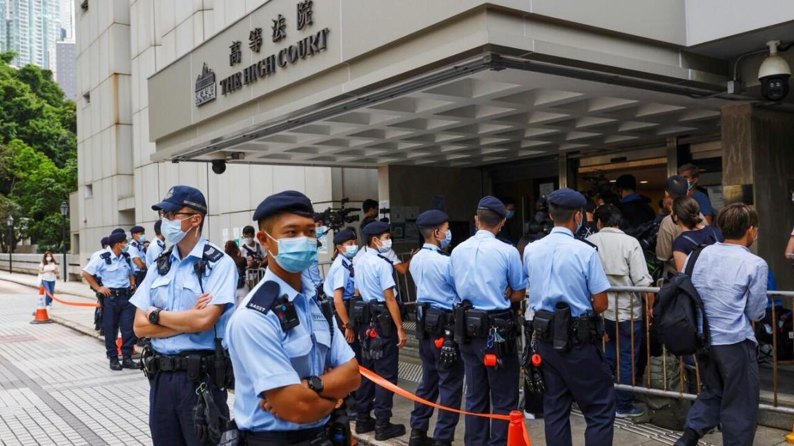Police stand guard in front of the High Court during the court hearing of Tong Ying-kit, the first person charged under a new national security law, in Hong Kong, China.  July 30, 2021.
