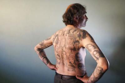 Miljenko Parserisas Bukovic ostenta 82 tatuagens da atriz Julia Roberts. (Foto: Eliseo Fernandez/Reuters)
