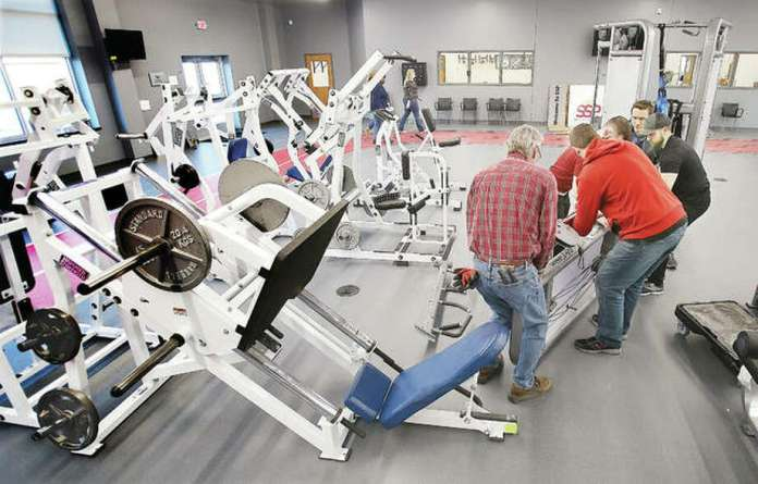 Workers were setting up the exercise room Friday at the new Senior Services Plus Wellness Center, which will have a soft opening on Monday and will have a grand opening ceremony on Feb. 4 at 3 p.m. Photo: John Badman | The Telegraph
