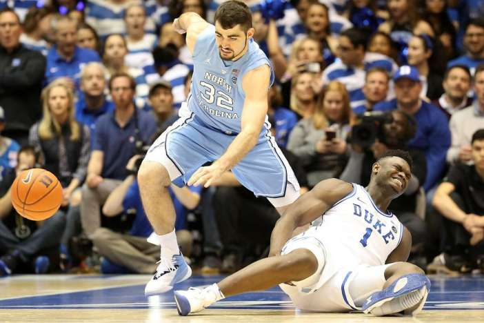 Zion Williamson #1 of the Duke Blue Devils reacts after falling as his shoe breaks against Luke Maye #32 of the North Carolina Tar Heels during their game at Cameron Indoor Stadium on February 20, 2019 in Durham, North Carolina. (Photo by Streeter Lecka/Getty Images)