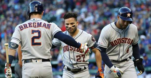 ARLINGTON, TEXAS - APRIL 19: Jose Altuve # 27 of the Houston Astros celebrates a two-run homer with Alex Bregman # 2 of the Houston Astros in the first inning against the Texas Rangers at Globe Life Park in Arlington on April 19 of 2019 Arlington, Texas. (Photo by Ronald Martinez / Getty Images) Photo: Ronald Martinez / Getty Images