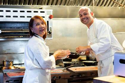 Chef Manny Torres Gimenez cooks with his mother Gaudy De Torres at Francisca in San Francisco, California on Tuesday, April 16, 2019.