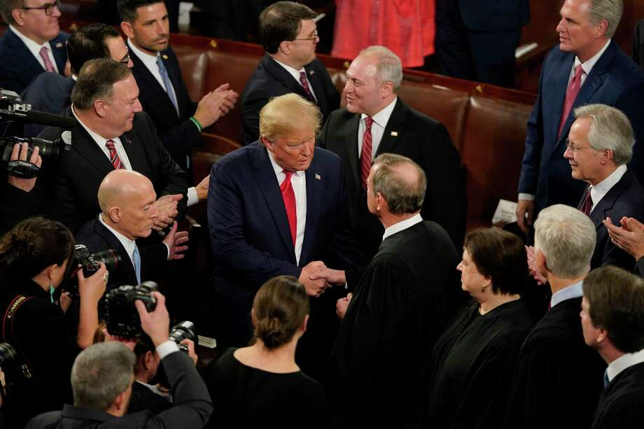 President Donald Trump greets Chief Justice John Roberts Jr. before the State of the Union address in the House chamber of the U.S. Capitol on Feb.y 4, 2020 in Washington, D.C. Photo: Washington Post Photo By Jabin Botsford / The Washington Post