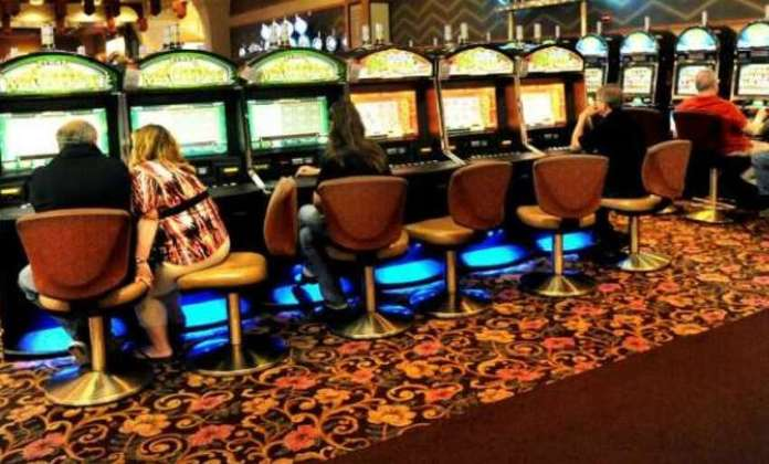 The players are playing the video slot machines on Tuesday, May 28, 2013, at Saratoga Casino and raceway Saratoga Springs, new york.