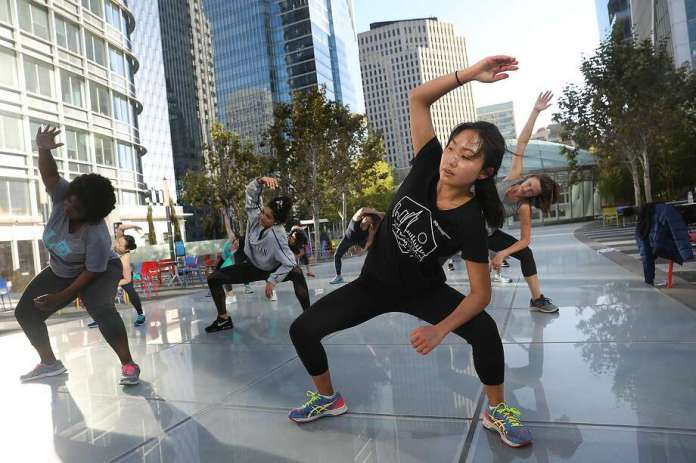 A free cardio zumba dance class offered by Fitness SF on the Salesforce Park roof in 2018. Photo: Liz Hafalia / The Chronicle