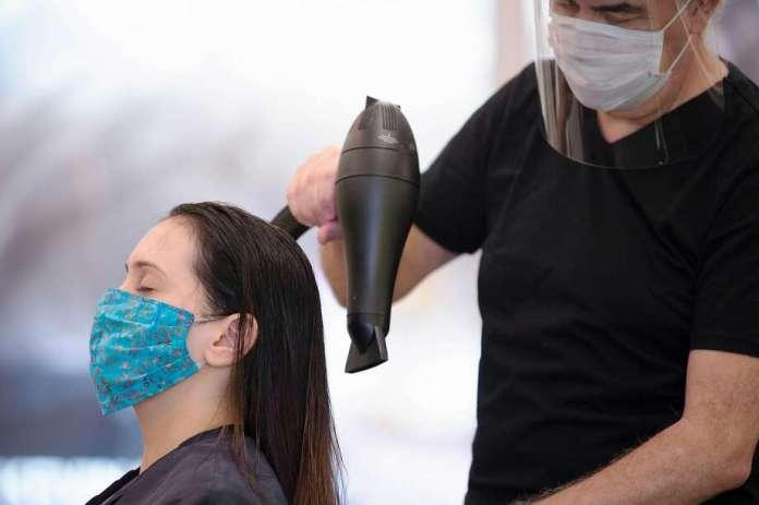 Last month, stylist Neck Gunes dries client Jennifer Nardelli's hair at St. Germain's hair salon in Washington, D.C. Photo: Jim Watson / AFP / Getty Images