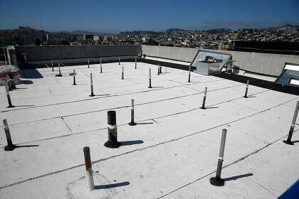 Stanchions are seen on the roof of Casa Adalante at 2060 Folsom Street and the San Francisco skyline beyond it on Monday, June 29, 2020 in San Francisco, Calif. The stanchions will support the solar panel grid for Casa Adalante after they are installed. Casa Adalante is an all-electric senior housing development.