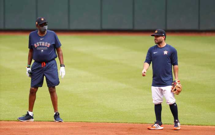 Houston Astros manager Dusty Baker wears a mask as he chatted with second baseman Jose Altuve during the first day of the Houston Astros Summer Camp at Minute Maid Park, Friday, July 3, 2020, in Houston.