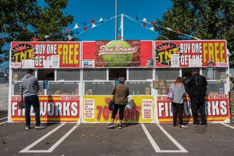 People line up to buy fireworks from a stand in San Bruno on Friday, July 3, 2020.