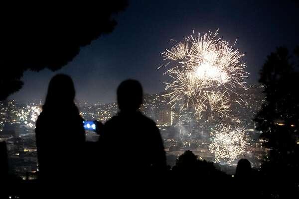 Fireworks burn in the Potrero Hill neighborhood of San Francisco.