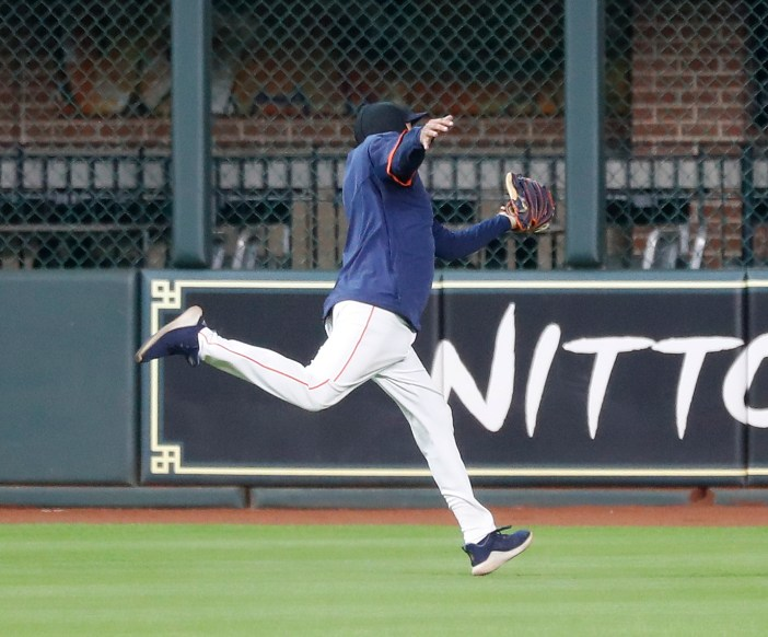 Houston Astros bullpen catcher Javier Bracamonte playing in center field robs Alex Bregman of a double to end the Houston Astros intrasquad game during the Astros summer camp at Minute Maid Park, Thursday, July 9, 2020, in Houston.