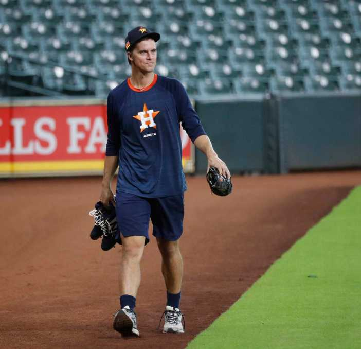 Houston Astros pitcher Zack Greinke walks back to the clubhouse after working out during the Astros summer camp at Minute Maid Park, Wednesday, July 15, 2020, in Houston.