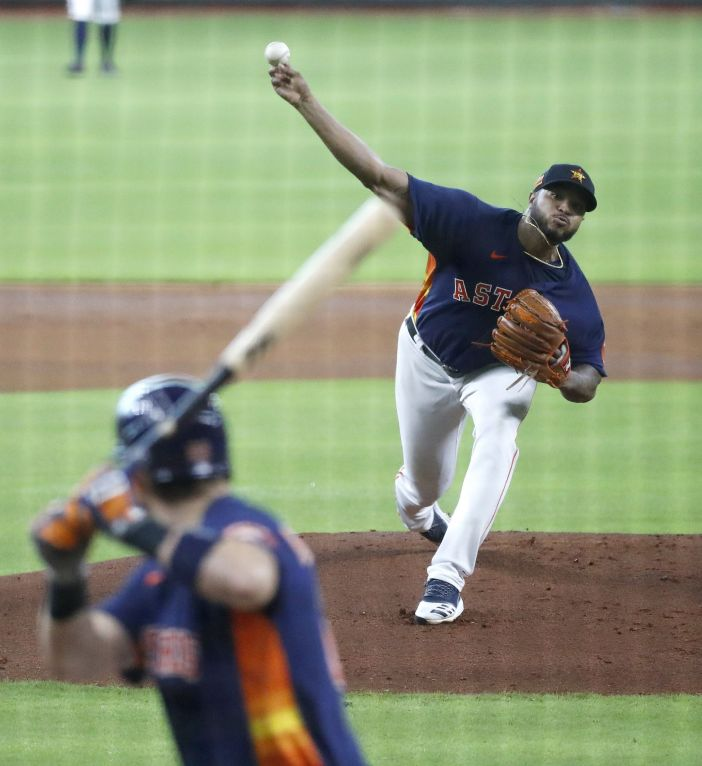 Houston Astros pitcher Josh James pitches to Josh Reddick in an interasquad game during the Astros summer camp at Minute Maid Park, Thursday, July 16, 2020, in Houston.
