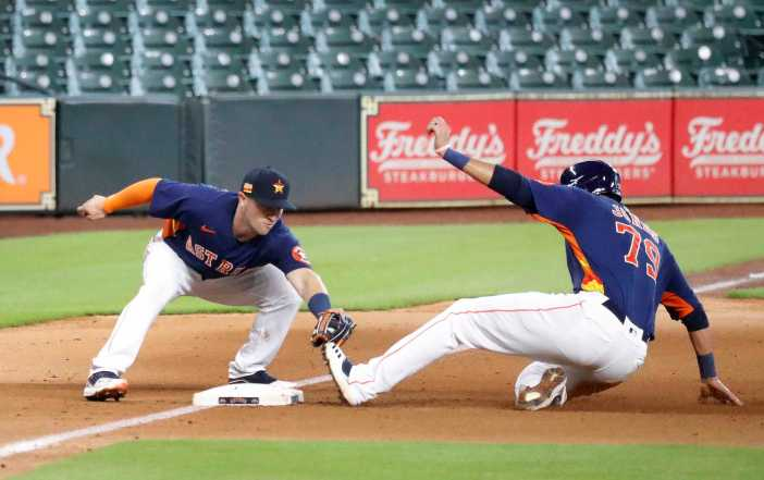 Houston Astros third baseman Alex Bregman tags Taylor Jones out at third base on Abraham Toro's double during an intrasquad game during the Astros summer camp at Minute Maid Park, Wednesday, July 22, 2020, in Houston.
