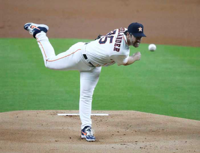 Houston Astros pitcher Justin Verlander pitches during the first inning an MLB Opening Day at Minute Maid Park, Friday, July 24, 2020, in Houston.