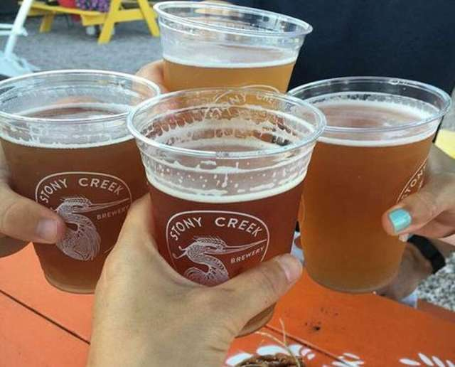 Friends toast a birthday at Stony Creek Brewery.  Photo: Cathy Amarante / Contributed by photos