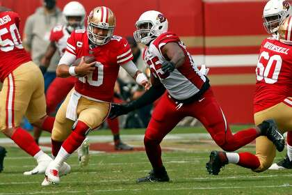 San Francisco 49ers' Jimmy Garoppolo is sacked by Arizona Cardinals' Chandler Jones in 2nd quarter during NFL game at Levi's Stadium in Santa Clara, Calif., on Sunday, September 13, 2020.