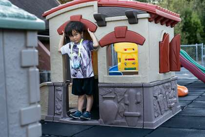 James Trinh, 5, shows how Maki Lemur got into this house before he was caught in the playground of the Hope Lutheran Playground on Friday, October 16, 2020 in South San Francisco, Calif.