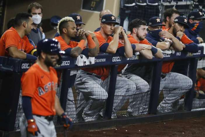 Players in the Houston Astros dugout watch the eighth inning of Game 7 of the American League Championship Series against the Tampa Bay Rays at Petco Park Saturday, Oct. 17, 2020, in San Diego.