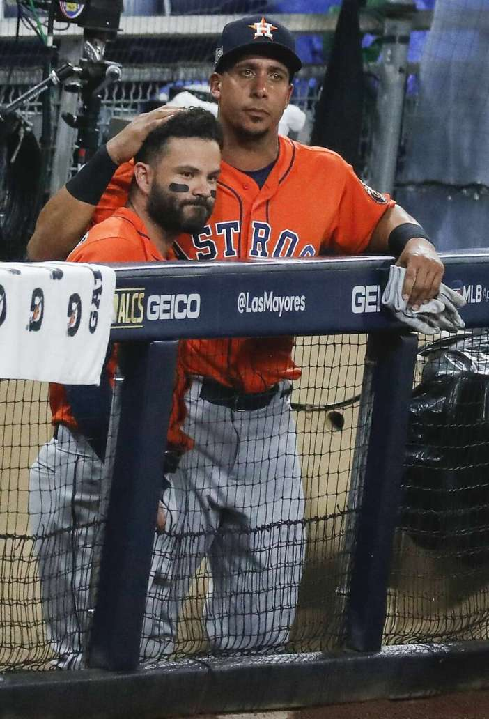 Houston Astros Jose Altuve, left, and Michael Brantley embrace after the Tampa Bay Rays eliminated the Astros in Game 7 of the American League Championship Series at Petco Park Saturday, Oct. 17, 2020, in San Diego. The Rays won Game 7 4-2.