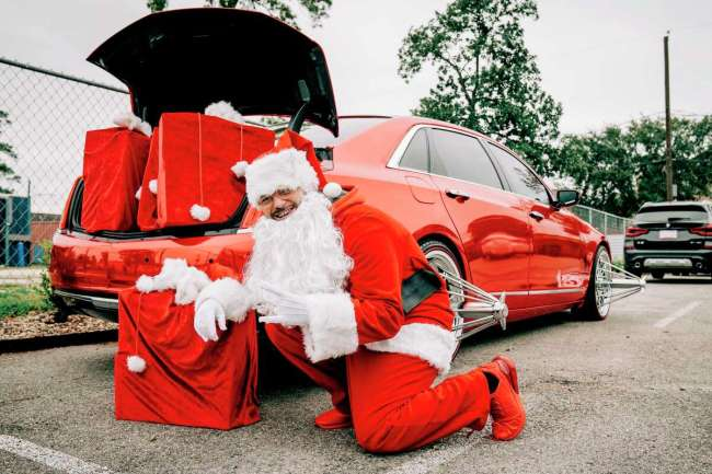 Paul Wall dressed as Santa Claus - although he called himself