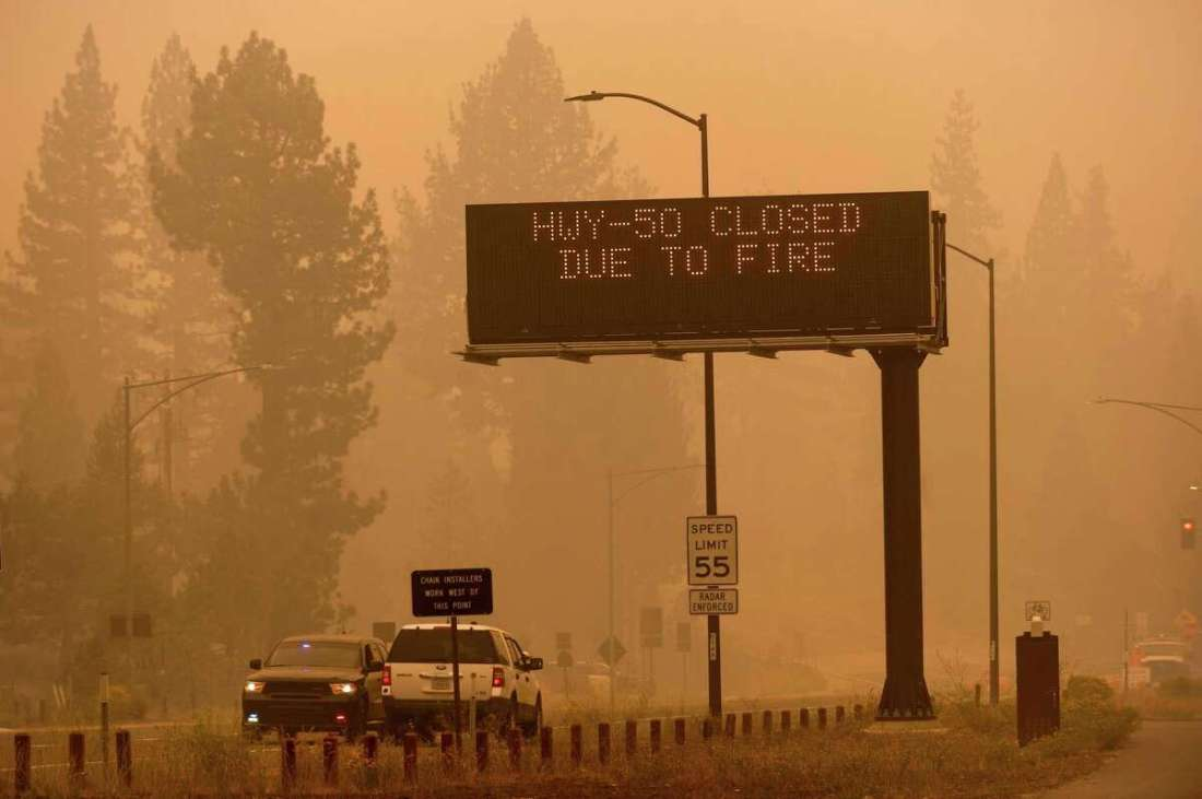 A sign in Eldorado County, Calif., warns motorists about the closure of Highway 50, which is shut down in both directions due to the Caldor Fire, on Friday, Aug. 27, 2021.