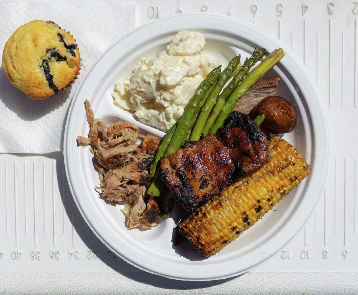 An assortment of barbecued meats and sides from GrilleeQ, including pulled pork, tri-tip, marinated chicken thighs and blueberry corn muffins. Founder Lee Thomas prepares customized meals for customers to pick up at his home in San Leandro.