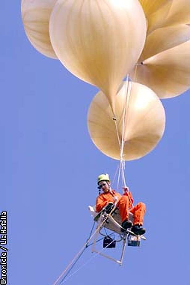 chair with balloons swing stand up and away a man his lawn take flight sfgate as stunt marking the 20th anniversary of larry graham s balloon in