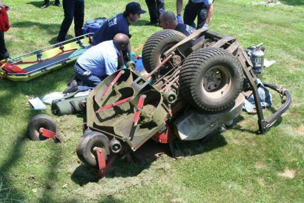 landscaper pinned under lawn tractor