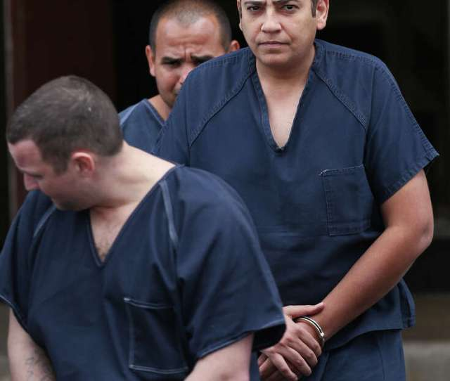 Security Escorts Iraqi Refugee Ahmed Tayyeh Out Of The Federal Courthouse Thursday Sept