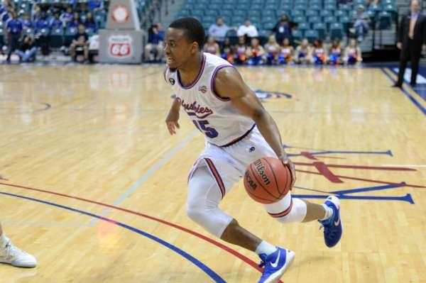 Chukwujekwu Strickland represent HBU basketball on
