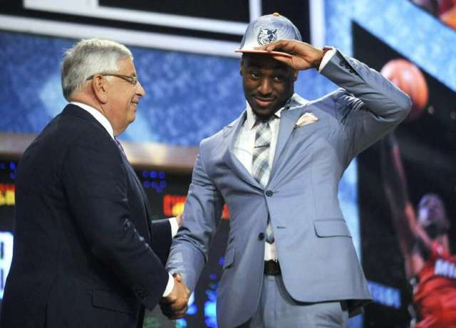 NBA Commissioner David Stern, left, poses with Connecticut's Kemba Walker, whom the Charlotte Bobcats selected with the ninth pick in the NBA basketball draft Thursday, June, 23, 2011, in Newark, N.J. (AP Photo/Bill Kostroun) Photo: AP / AP2011