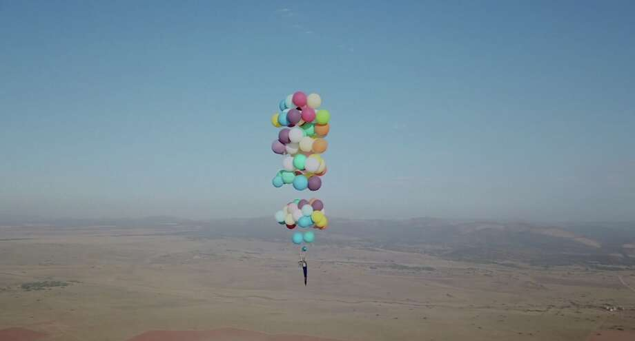 chair with balloons bean bag baby video photos man flies for miles in a lawn buoyed by 100 tom morgan of bristol england soared 8 000 feet above south africa
