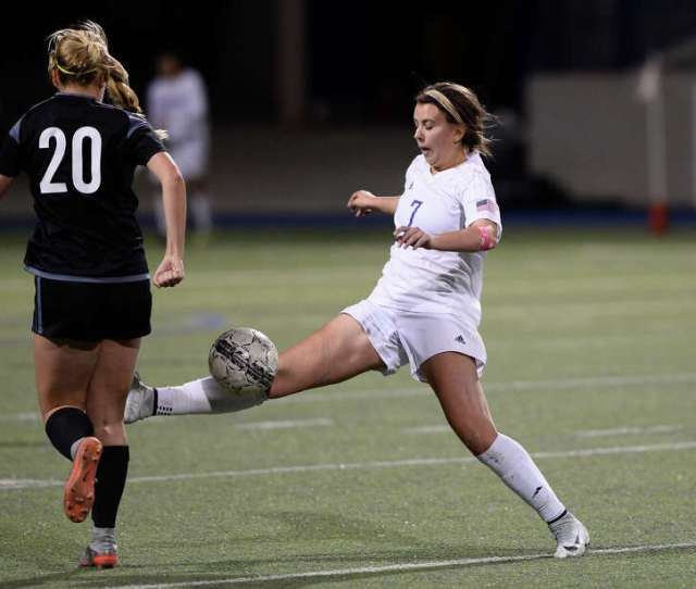 Midland Highs Kylie Vonholle Kicks The Ball Away From Permians Briana Moore 20 On