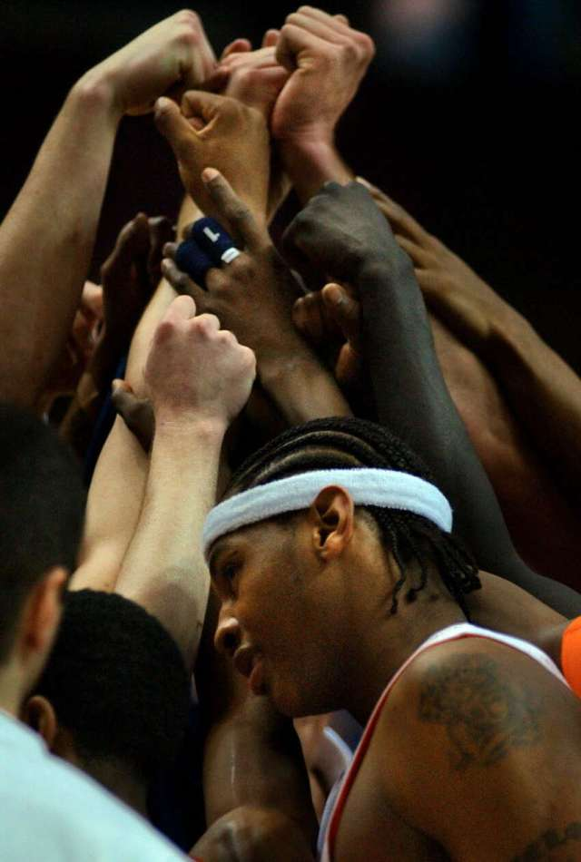 Syracuse University freshman star forward Carmelo Anthony, foreground, stands with his teammates at the end of practice at the Pepsi Arena on March 27, 2003.