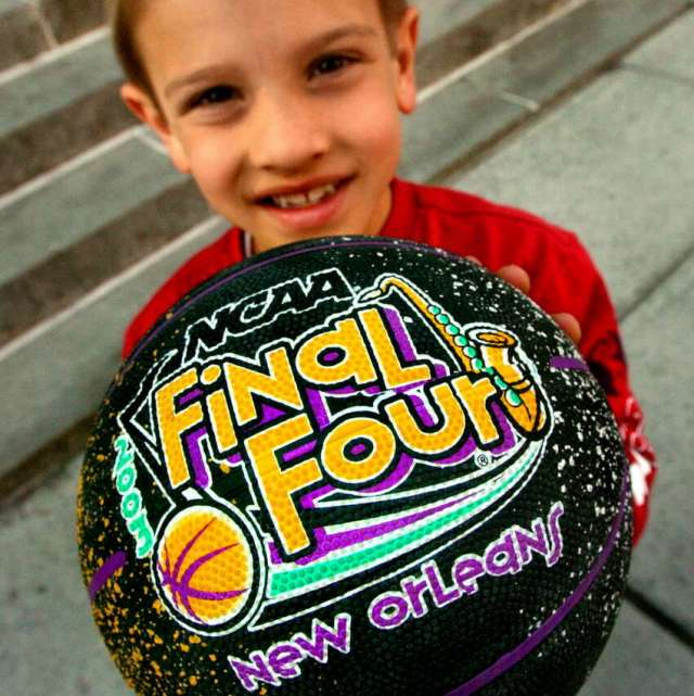 Joseph Bacon, 7, of Little Rock, Ark. holds up his new NCAA basketball Friday, March 28, 2003, outside the Pepsi Arena in Albany.