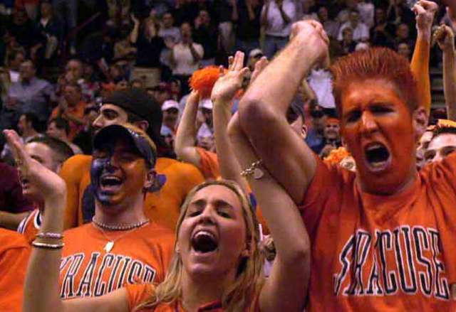Syracuse University fans cheer their team during the NCAA Tournament in Pepsi Arena March 28, 2003.