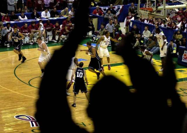 Fans cheer during the NCAA Tournament in Albany's Pepsi Arena on March 28, 2003.