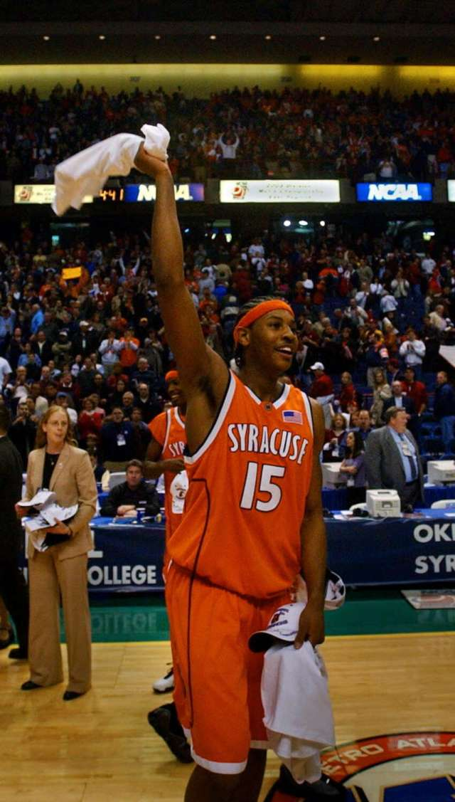 Syracuse University forward Carmelo Anthony celebrates his team's 63-47 victory over Oklahoma in the NCAA East Regional at the Pepsi Arena in Albany on March 30, 2003.
