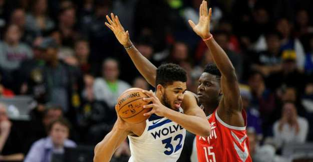 Clint Capela #15 of the Houston Rockets defends against Karl-Anthony Towns #32 of the Minnesota Timberwolves during the game on February 13, 2018 at the Target Center in Minneapolis. Photo: Hannah Foslien/Getty Images