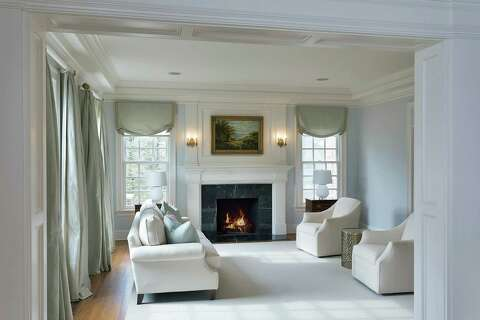 formal living room with brick fireplace paint ideas brown leather furniture on the market and slate estate boasts 10 000 square feet in there is a marble custom baseboard crown