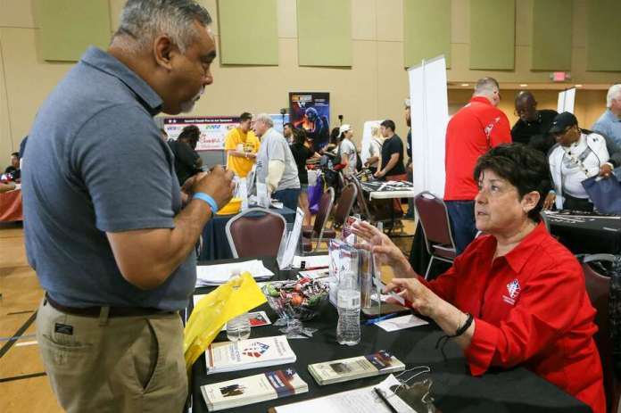 Della Lopez (right) with the Texas Veterans Commission speaks with Ramon Gonzales during the seventh annual Welcome Home event honoring service members and their families at Morgan's Wonderland on Saturday, May 19, 2018.  The event, hosted by the South Texas Veterans Health Care System, brought together community partners offering service and support to the Veteran and military communities to one location in a fun, family environment.  MARVIN PFEIFFER/mpfeiffer@express-news.net Photo: Marvin Pfeiffer, Staff / San Antonio Express-News / Express-News 2018