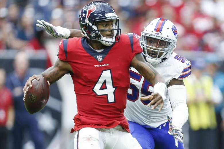 Houston Texans quarterback Deshaun Watson (4) is pursued by Buffalo Bills defensive end Jerry Hughes (55) during the third quarter as the Houston Texans take on the Buffalo Bills at NRG Stadium Sunday Oct. 14, 2018 in Houston. Photo: Michael Ciaglo/Staff Photographer