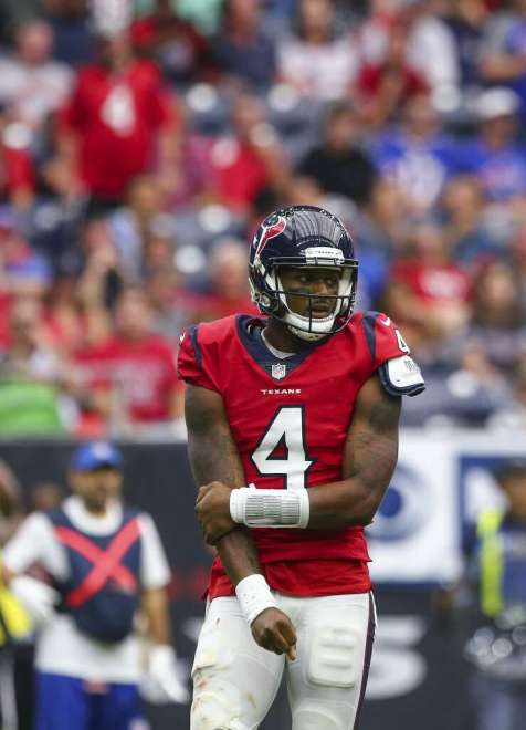 Houston Texans quarterback Deshaun Watson (4) holds his right arm after being tackled during the fourth quarter of an NFL game against the Buffalo Bills at NRG Stadium Sunday, Oct. 14, 2018, in Houston. The Texans won 20-13. Photo: Godofredo A. Vasquez/Staff Photographer