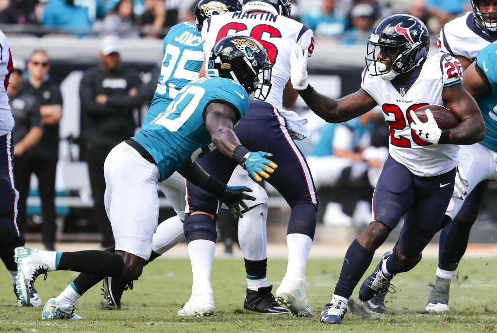 Houston Texans running back Lamar Miller (26) runs against Jacksonville Jaguars linebacker Telvin Smith (50) during the second quarter of an NFL football game at TIAA Bank Field on Sunday, Oct. 21, 2018, in Jacksonville. Photo: Brett Coomer/Staff Photographer